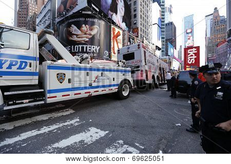Towing wrecked bus from Duffy Square