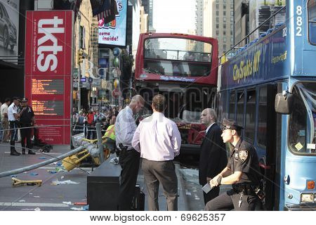 NYPD standing outside wrecked buses