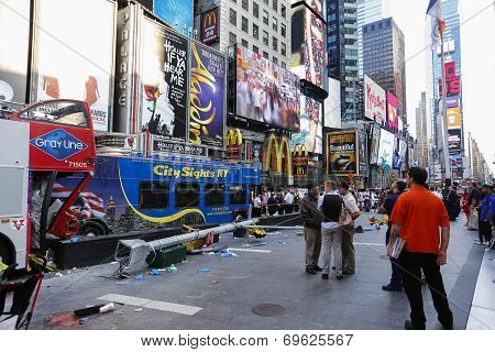 Wrecked buses with Times Square background
