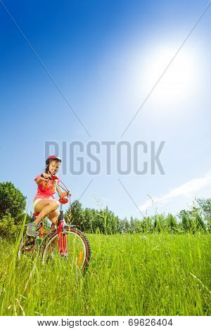 Nice young girl sitting on a bike
