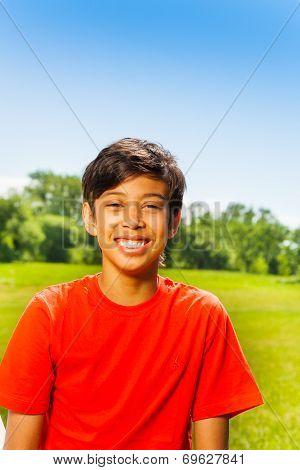 Brunet happy boy in red T-shirt portrait