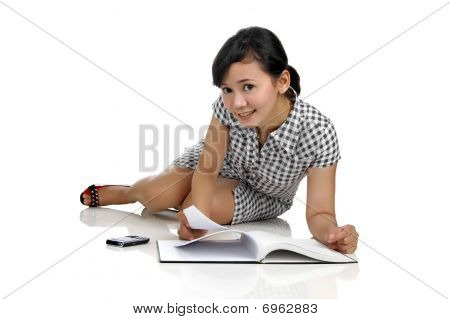 Woman Lying While Reading Book