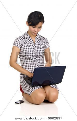 Woman, Cellphone, And Laptop