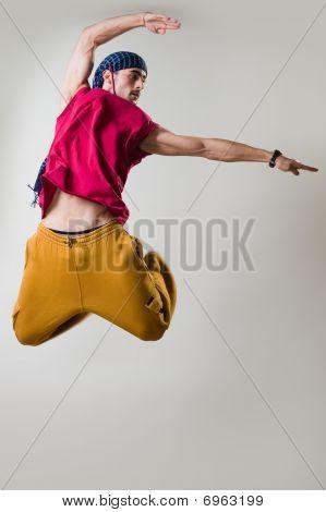Dancer Jumping Over Light Background