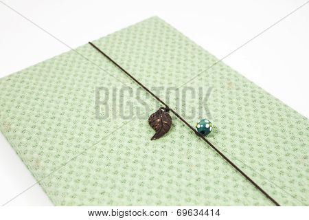 Notebook With Green Cover Isolated On White Background