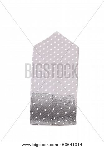 Folded gray tie with white speck.
