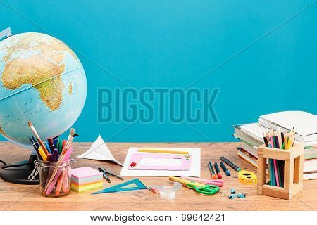 School Accessories On Desktop With Plain Background
