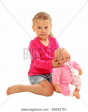 Little Girl With Her Favourite Doll