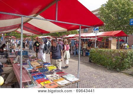 Shopping People At Market Stalls Of Historic Book Fair