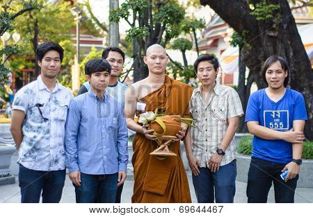 family in Buddhist ordination ceremony
