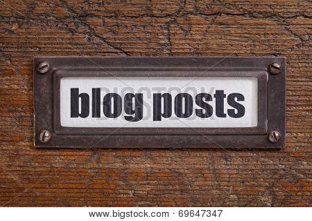 blog posts   tag - file cabinet label, bronze holder against grunge and scratched wood -internet publishing concept