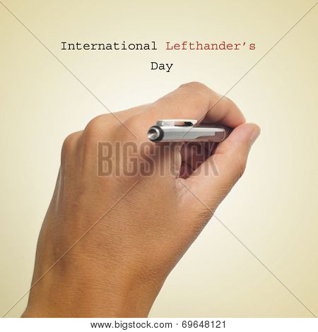 a man left-hand with a pen and the sentence International Lefthanders Day on a beige background