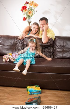 Cute little girl having fun with presents