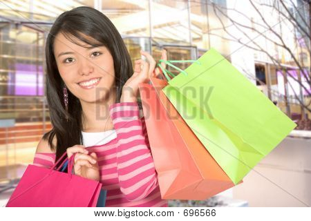 Beautiful Girl With Her Shopping Bags