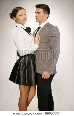 Middle Age Couple in Black and White Shade Fashion Attire Portrait. Isolated on Gray background.