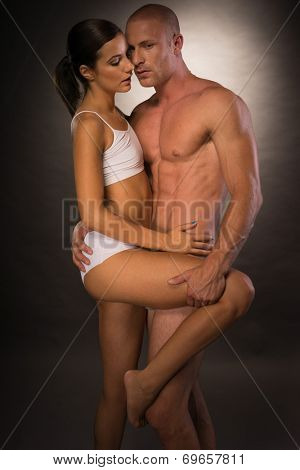 Very Sexy Young Partners Showing Seductive Pose Flaunting Nice Body Curves and Lines. Isolated on Gray Background