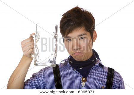 Young man Looks Sad, With Empty Oktoberfest Beer Stein