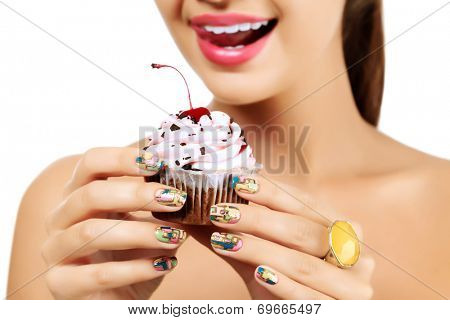 Woman wants to eat a cupcake