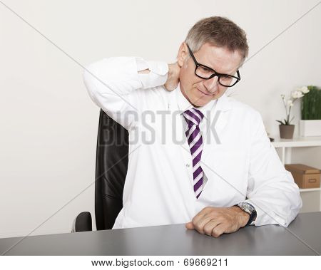 Exhausted Physician Holding Back Neck