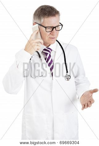 Puzzled Doctor Talking On His Mobile Phone