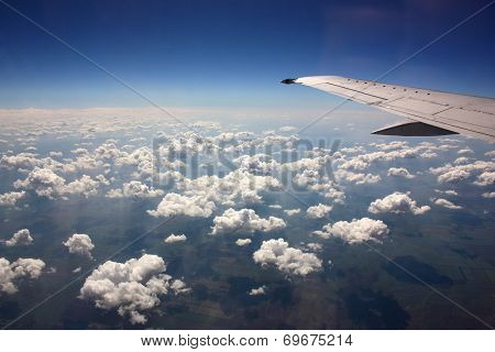 The View From The Window Of A Jet Airplane Wing And Beautiful Clouds