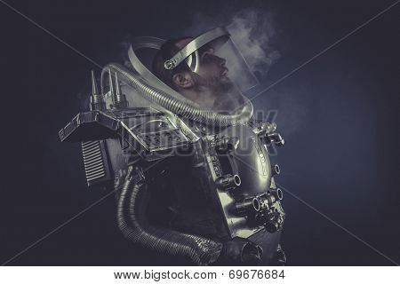 spaceman in silver armor and huge cannon