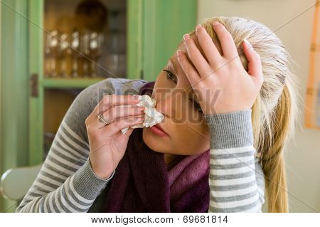 woman on sick leave with handkerchief. symbolic photo for colds, flu and flu season