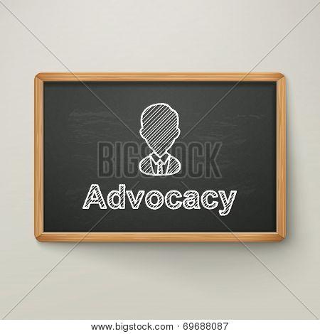 Advocacy On Blackboard In Wooden Frame