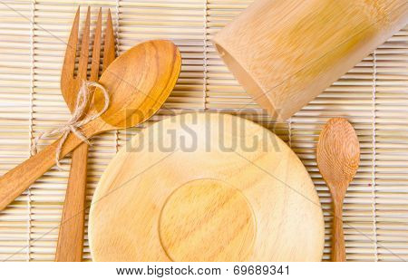 Handcrafted Wooden Kitchen Utensils On Bamboo Weave