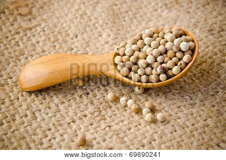 Allspice Peppercorns In Wooden Spoon