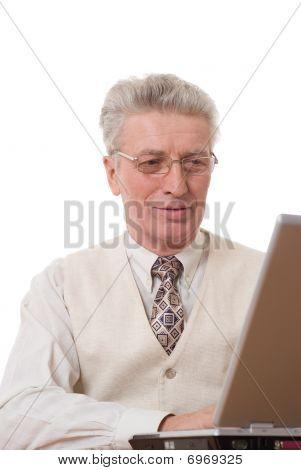Smiling Mature Businessman Pointing Upwards On White
