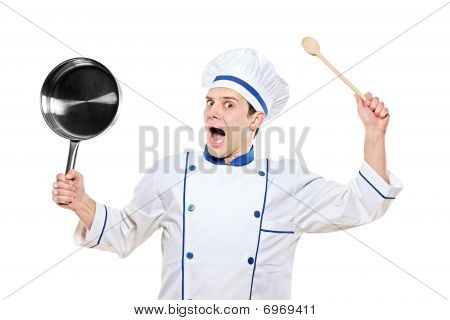 Stunned chef holding kitchen utensil