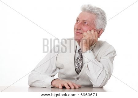 Smiling Mature Businessman Pointing Upwards On White