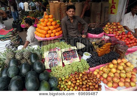 KOLKATA, INDIA - FEBRUARY 11: Street trader sell fruits outdoor on February 11, 2014 in Kolkata India. Only 0.81% of the Kolkata's workforce employed in the primary sector (agriculture)