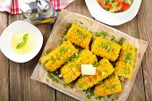 image of corn cob close-up  - Grilled corn cobs on table - JPG