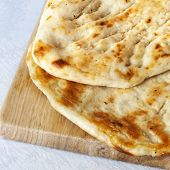 stock photo of flat-bread  - Fresh Turkish garlic bread ready to eat - JPG