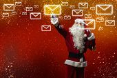 stock photo of letters to santa claus  - Santa Claus reading children letters with wishes - JPG
