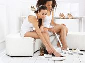 pic of covenant  - Women buy shoes at a shoe store - JPG