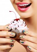 pic of finger-licking  - Woman wants to eat a cupcake  - JPG