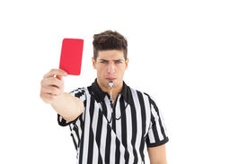 image of referee  - Stern referee showing red card on white background - JPG
