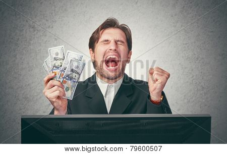 Happy Businessman With Money In Hand  And Computer