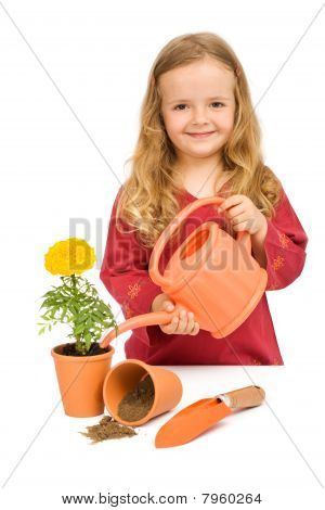Little Girl Planting Flowers In Pots