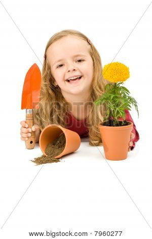Happy Little Girl With Potted Flower
