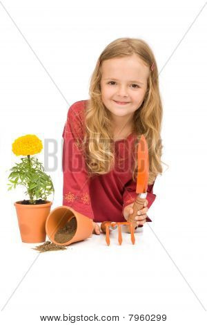 Little Girl With Gardening Tools And Potted Flower