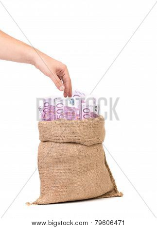 hand with money bag