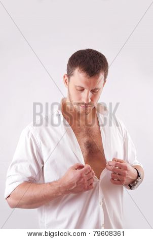 Young Man With Beautiful Face, Muscular Torso, Dressed In White Unbuttoned Shirt