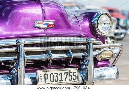 HAVANA, CUBA - DECEMBER 14, 2014 : Classic chevrolet and other colorful vintage american cars