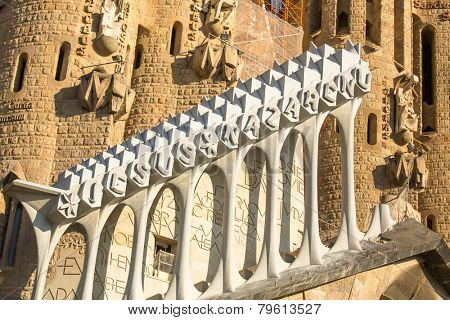 BARCELONA, SPAIN - DEC 24, 2014: Detail of a wall La Sagrada Familia - the impressive cathedral designed by Gaudi, which is being build since Mar 19, 1882 and is not finished yet.