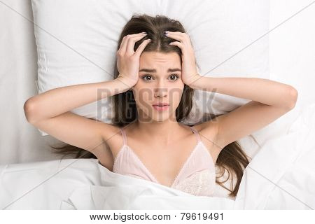 beauty lying in the bed struggling to wake up