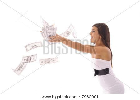 beautiful woman in a dress catching money